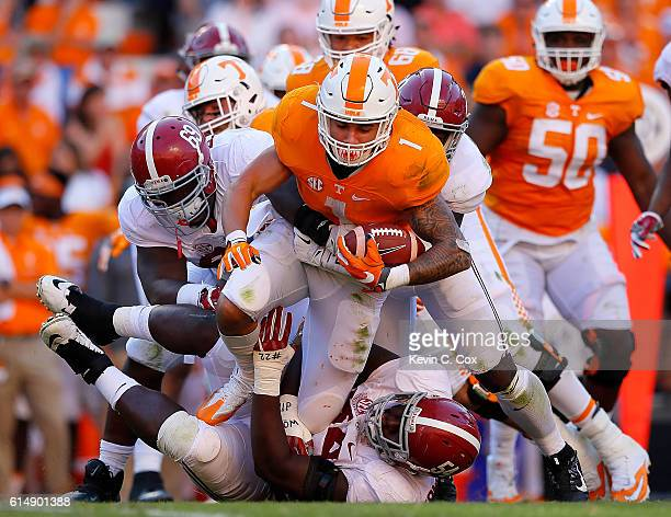 Jalen Hurd of the Tennessee Volunteers is tackled by Joshua Frazier Dalvin Tomlinson and Shaun Dion Hamilton of the Alabama Crimson Tide at Neyland...