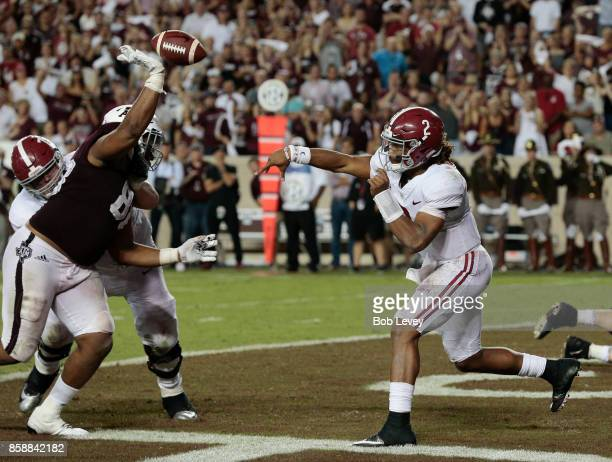 Jalen Hurts of the Alabama Crimson Tide has his pass attempt knocked down by Kingsley Keke of the Texas AM Aggies in the fourth quarter at Kyle Field...