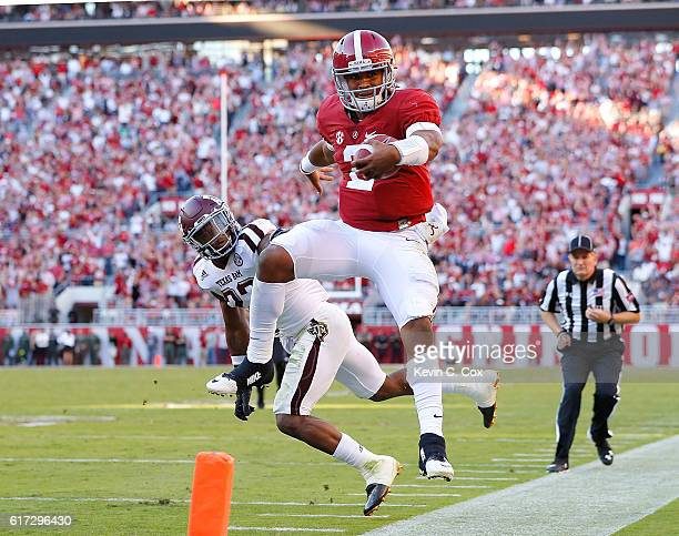 Jalen Hurts of the Alabama Crimson Tide is pushed out of bounds during this rush against Armani Watts of the Texas AM Aggies at BryantDenny Stadium...