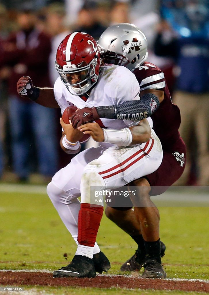 Jalen Hurts #2 of the Alabama Crimson Tide is sacked by Mark McLaurin #41 of the Mississippi State Bulldogs during the second half of an NCAA football game at Davis Wade Stadium on November 11, 2017 in Starkville, Mississippi.