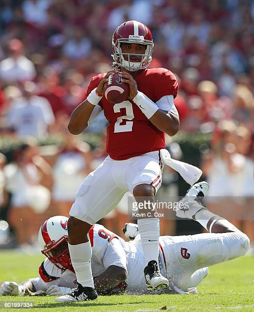Jalen Hurts of the Alabama Crimson Tide looks to pass against the Western Kentucky Hilltoppers at BryantDenny Stadium on September 10 2016 in...
