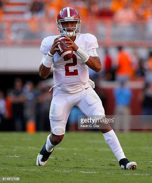 Jalen Hurts of the Alabama Crimson Tide looks to pass against the Tennessee Volunteers at Neyland Stadium on October 15 2016 in Knoxville Tennessee