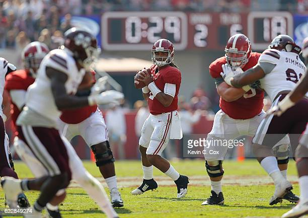 Jalen Hurts of the Alabama Crimson Tide looks to pass against the Mississippi State Bulldogs at BryantDenny Stadium on November 12 2016 in Tuscaloosa...