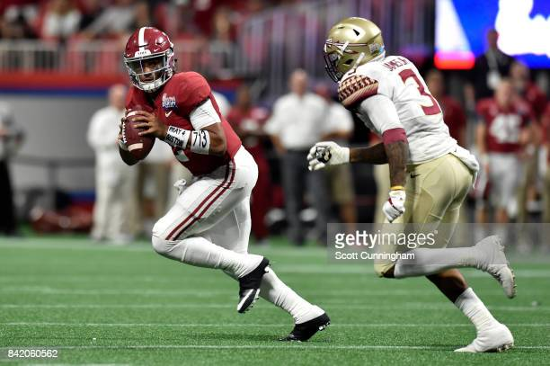 Jalen Hurts of the Alabama Crimson Tide looks to pass against the Florida State Seminoles during their game against the Florida State Seminoles at...