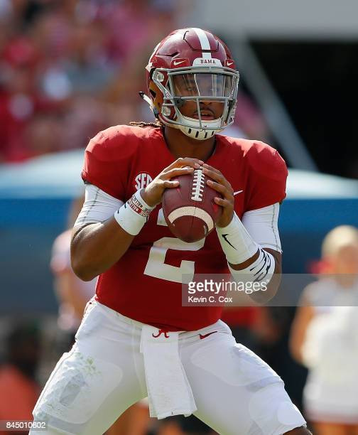 Jalen Hurts of the Alabama Crimson Tide looks to pass against the Fresno State Bulldogs at BryantDenny Stadium on September 9 2017 in Tuscaloosa...