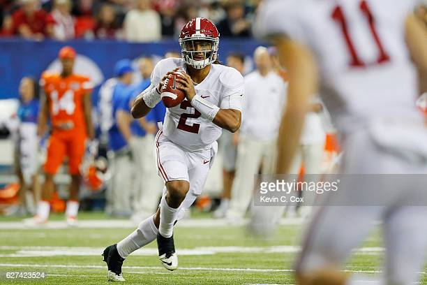 Jalen Hurts of the Alabama Crimson Tide looks to pass in the first quarter against the Florida Gators during the SEC Championship game at the Georgia...
