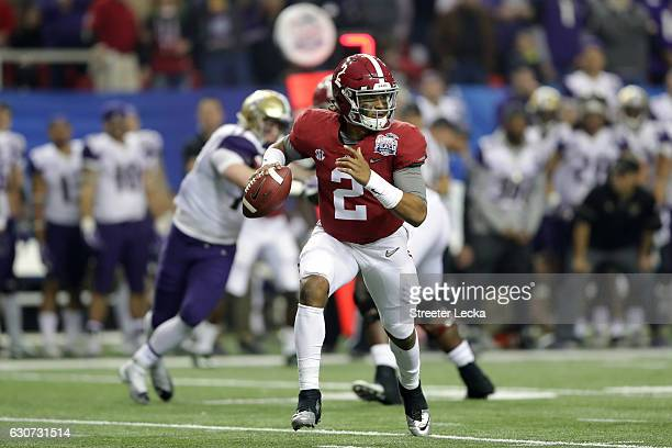 Jalen Hurts of the Alabama Crimson Tide on aginst the Washington Huskies during the 2016 ChickfilA Peach Bowl at the Georgia Dome on December 31 2016...