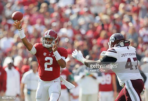 Jalen Hurts of the Alabama Crimson Tide passes against AJ Jefferson of the Mississippi State Bulldogs at BryantDenny Stadium on November 12 2016 in...