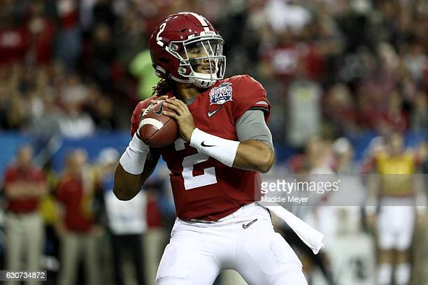 Jalen Hurts of the Alabama Crimson Tide passes the ball against the Washington Huskies during the 2016 ChickfilA Peach Bowl at the Georgia Dome on...