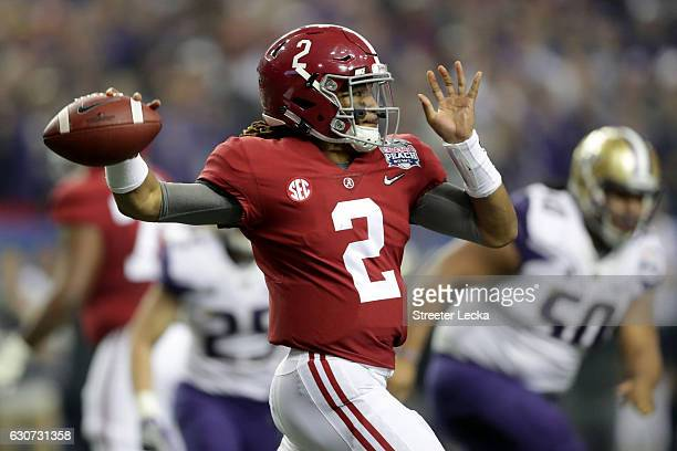 Jalen Hurts of the Alabama Crimson Tide passes the ball during the 2016 ChickfilA Peach Bowl at the Georgia Dome on December 31 2016 in Atlanta...