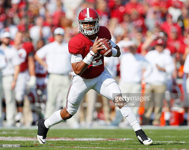 Jalen Hurts of the Alabama Crimson Tide rolls out of the pocket against the Mississippi State Bulldogs at BryantDenny Stadium on November 12 2016 in...