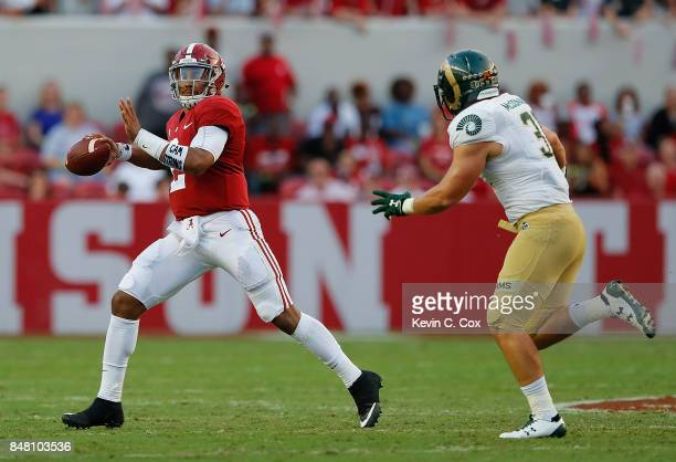 Jalen Hurts of the Alabama Crimson Tide rolls out to pass against Max McDonald of the Colorado State Rams at BryantDenny Stadium on September 16 2017...