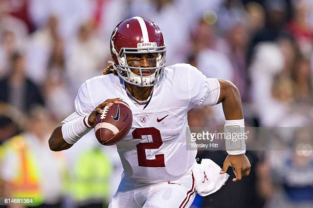 Jalen Hurts of the Alabama Crimson Tide rolls out to pass during a game against the Arkansas Razorbacks at Razorback Stadium on October 8 2016 in...