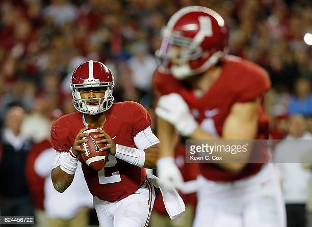 Jalen Hurts of the Alabama Crimson Tide rolls out to pass for a touchdown against the Chattanooga Mocs at BryantDenny Stadium on November 19 2016 in...