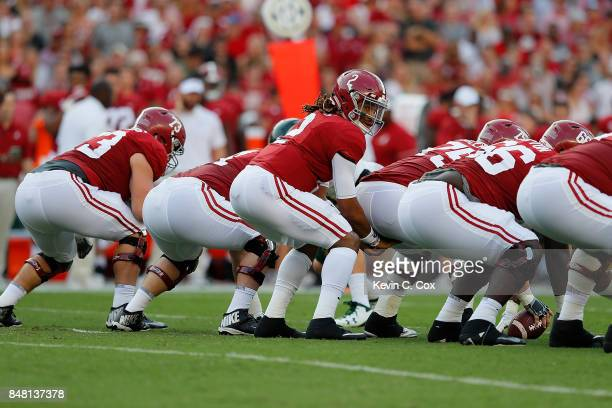 Jalen Hurts of the Alabama Crimson Tide runs the offense against the Colorado State Rams at BryantDenny Stadium on September 16 2017 in Tuscaloosa...