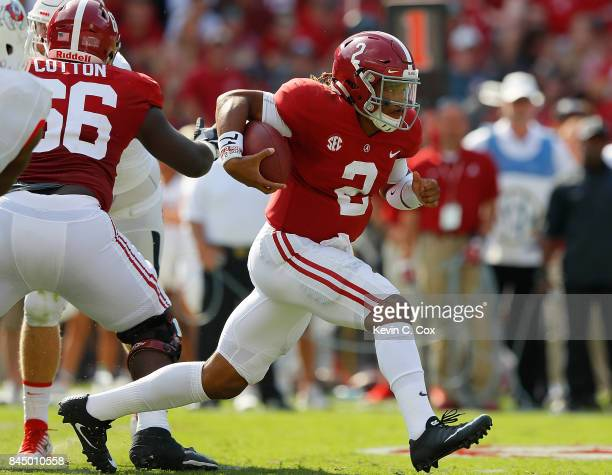 Jalen Hurts of the Alabama Crimson Tide rushes against the Fresno State Bulldogs at BryantDenny Stadium on September 9 2017 in Tuscaloosa Alabama