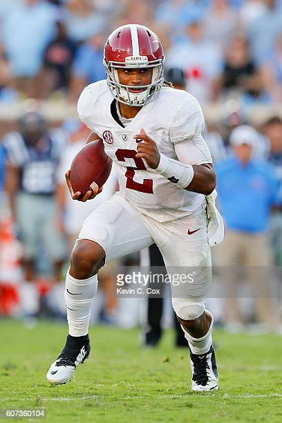 Jalen Hurts of the Alabama Crimson Tide rushes against the Mississippi Rebels at VaughtHemingway Stadium on September 17 2016 in Oxford Mississippi