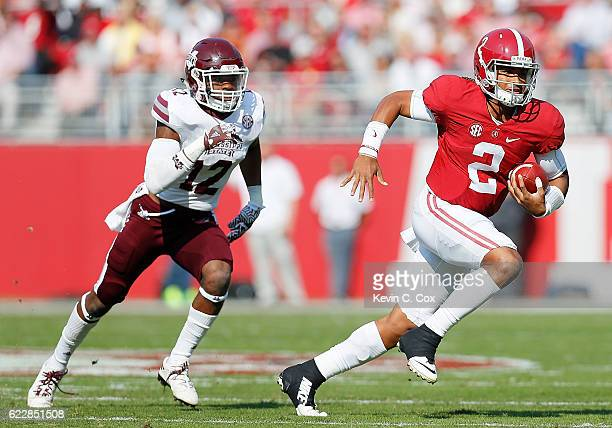 Jalen Hurts of the Alabama Crimson Tide rushes away from JT Gray of the Mississippi State Bulldogs at BryantDenny Stadium on November 12 2016 in...