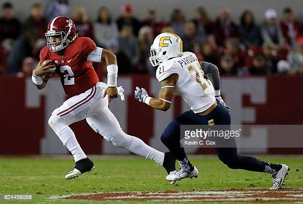 Jalen Hurts of the Alabama Crimson Tide rushes away from Montrell Pardue of the Chattanooga Mocs at BryantDenny Stadium on November 19 2016 in...