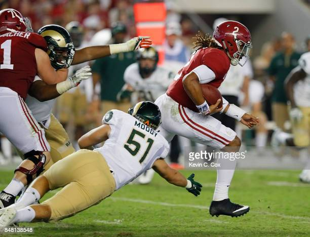 Jalen Hurts of the Alabama Crimson Tide rushes away from Patrick Moody of the Colorado State Rams at BryantDenny Stadium on September 16 2017 in...