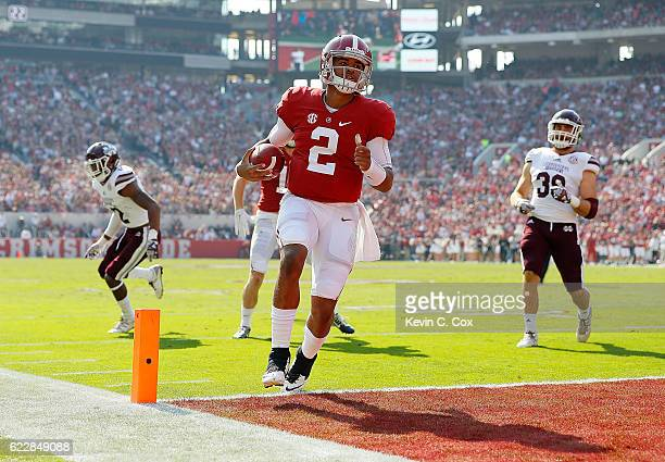 Jalen Hurts of the Alabama Crimson Tide rushes for a touchdown against the Mississippi State Bulldogs at BryantDenny Stadium on November 12 2016 in...
