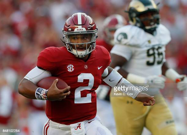 Jalen Hurts of the Alabama Crimson Tide rushes for a touchdown against the Colorado State Rams at BryantDenny Stadium on September 16 2017 in...