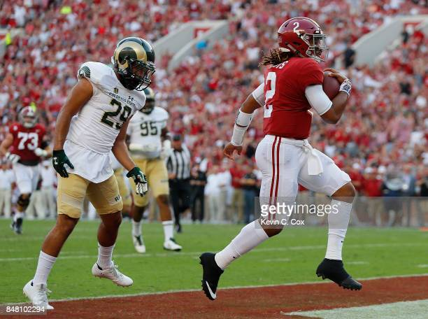 Jalen Hurts of the Alabama Crimson Tide rushes for this touchdown against Justin Sweet of the Colorado State Rams at BryantDenny Stadium on September...