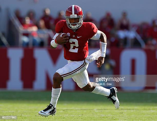 Jalen Hurts of the Alabama Crimson Tide rushes the ball against the Western Kentucky Hilltoppers at BryantDenny Stadium on September 10 2016 in...