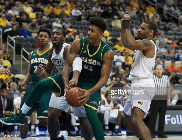 Jalen Jenkins of the George Mason Patriots and Mo AlieCox of the Virginia Commonwealth Rams fight for the ball in the Quarterfinals of the men's...