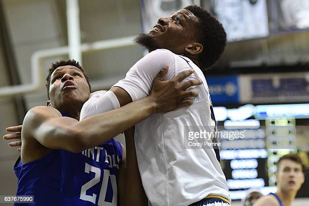 Jalen Johnson of the Saint Louis Billikens wraps up with Demetrius Henry of the La Salle Explorers during the first half at Tom Gola Arena on January...