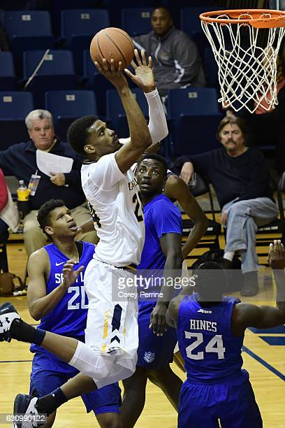Jalen Johnson Reggie Agbeko and Aaron Hines of the Saint Louis Billikens watch as Demetrius Henry of the La Salle Explorers picks up the score and...