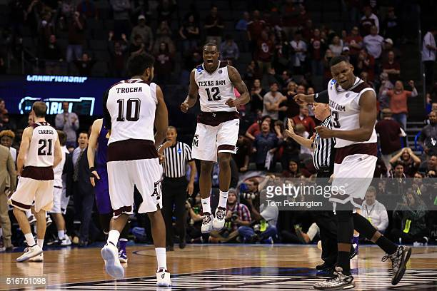 Jalen Jones of the Texas AM Aggies celebrates with his teammates after they tied up the score to go to overtime against the Northern Iowa Panthers...