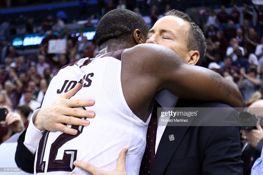 Jalen Jones #12 of the Texas A&M Aggies hugs head coach Billy Kennedy after defeating the Northern Iowa Panthers in double overtime with a score of 88 to 92 during the second round of the 2016 NCAA Men's Basketball Tournament at Chesapeake Energy Arena on March 20, 2016 in Oklahoma City, Oklahoma.