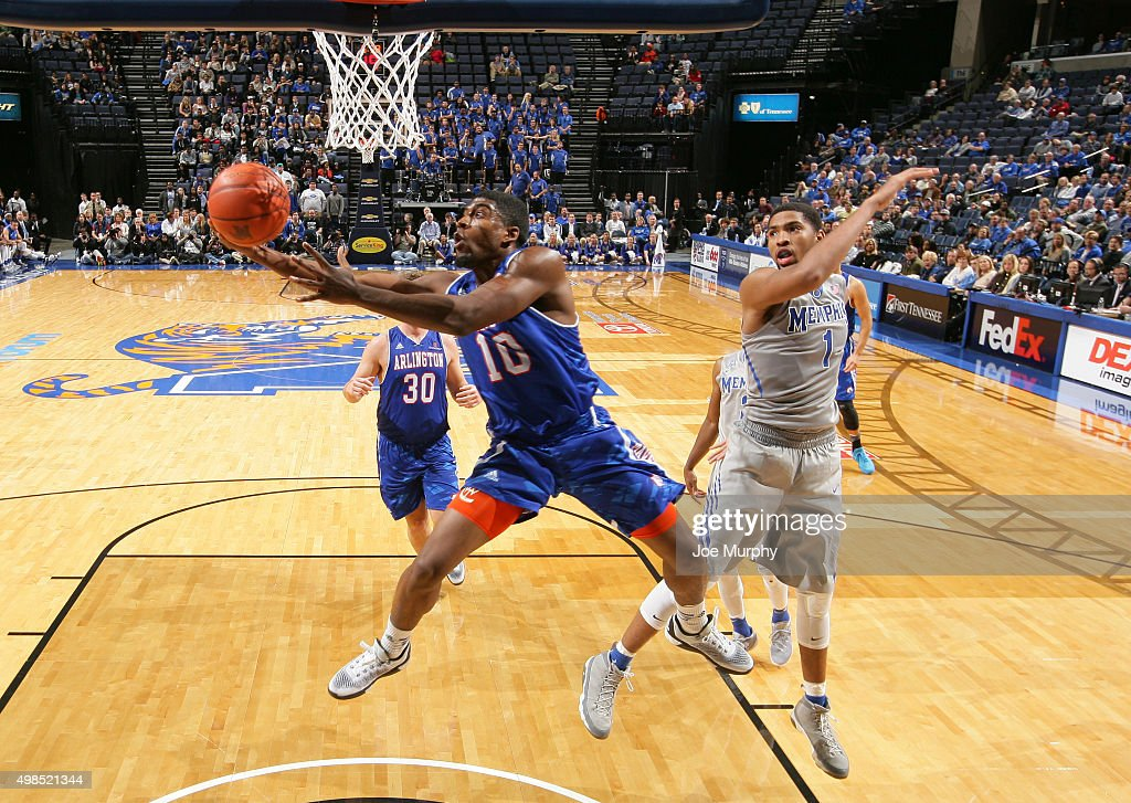Jalen Jones of the UT Arlington Mavericks drives to the basket for a layup against Dedric Lawson of the Memphis Tigers on November 23 2015 at...