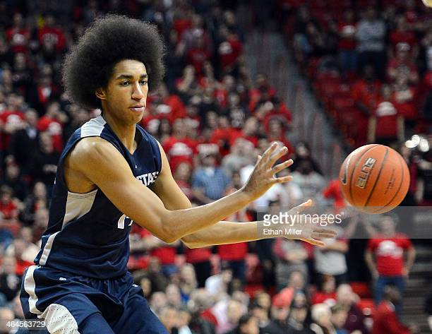 Jalen Moore of the Utah State Aggies passes against the UNLV Rebels during their game at the Thomas Mack Center on January 22 2014 in Las Vegas...