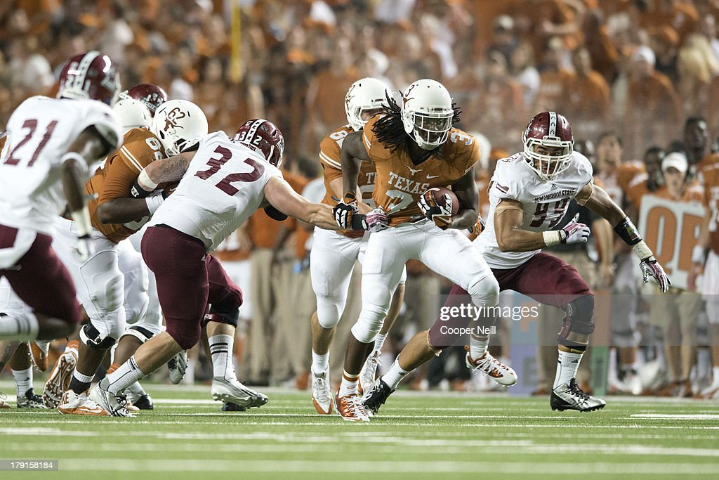 Jalen Overstreet #3 of the Texas Longhorns breaks away from the New Mexico State Aggies on August 31, 2013 at Darrell K Royal-Texas Memorial Stadium in Austin, Texas.