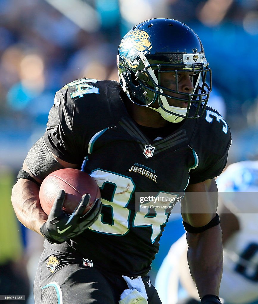 Jalen Parmele #34 of the Jacksonville Jaguars runs for yardage during the game against the Tennessee Titans at EverBank Field on November 25, 2012 in Jacksonville, Florida.