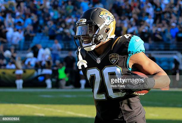 Jalen Ramsey celebrates after running an interception back for a touchdown during the fourth quarter of the game against the Tennessee Titans at...