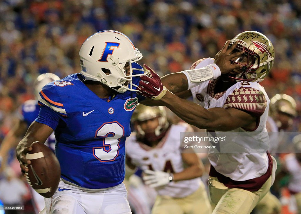 Jalen Ramsey of the Florida State Seminoles attempts to tackle Treon Harris of the Florida Gators during the game at Ben Hill Griffin Stadium on...