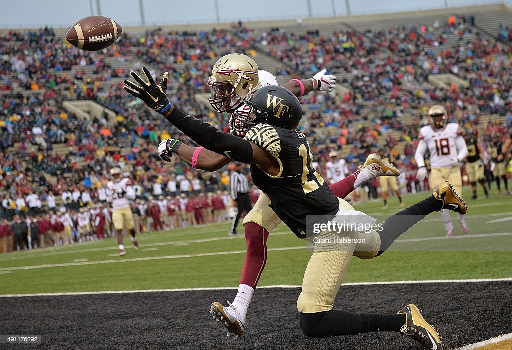 Jalen Ramsey of the Florida State Seminoles defends a pass to Cortez Lewis of the Wake Forest Demon Deacons in the end zone during their game at BBT...