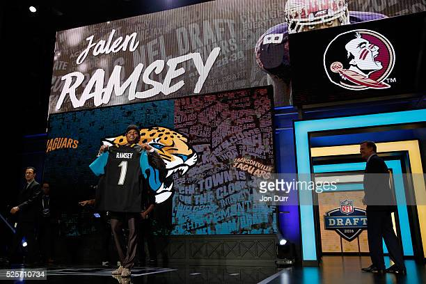 Jalen Ramsey of the Florida State Seminoles holds up a jersey after being picked overall by the Jacksonville Jaguars during the first round of the...