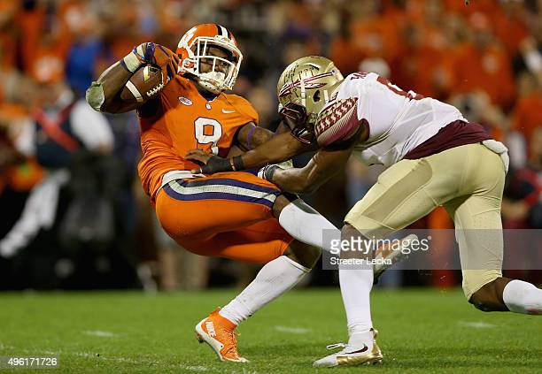Jalen Ramsey of the Florida State Seminoles misses a tackle against Wayne Gallman of the Clemson Tigers during their game at Memorial Stadium on...