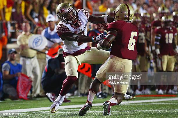 Jalen Ramsey of the Florida State Seminoles tackles Sherman Alston of the Boston College Eagles during the second half at Alumni Stadium on September...