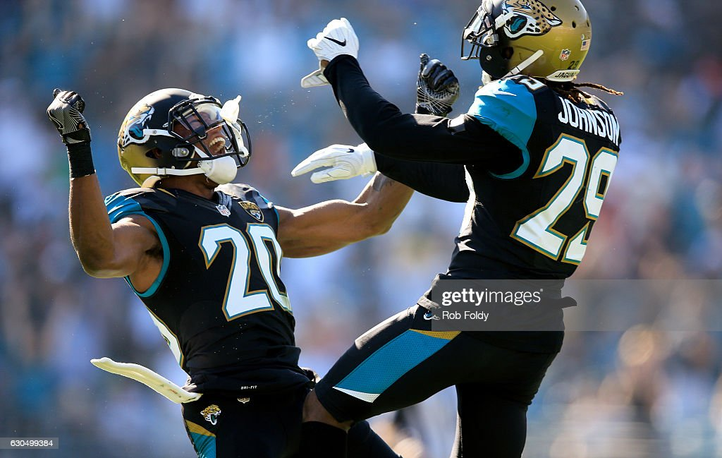 Jalen Ramsey #20 of the Jacksonville Jaguars celebrates with teammate Josh Johnson #29 after a defensive stop during the first half of the game against the Tennessee Titans at EverBank Field on December 24, 2016 in Jacksonville, Florida.
