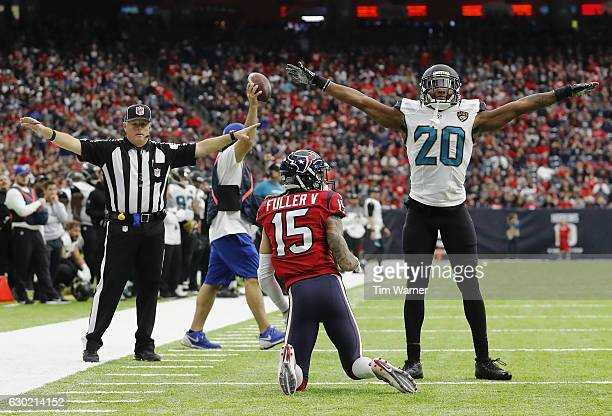 Jalen Ramsey of the Jacksonville Jaguars signals incomplete after defending Will Fuller of the Houston Texans in the fourth quarter at NRG Stadium on...