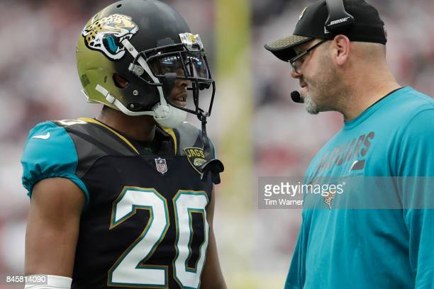 Jalen Ramsey of the Jacksonville Jaguars talks with defensive coordinator Todd Wash in the third quarter against the Houston Texans at NRG Stadium on...