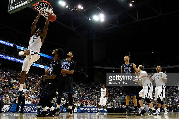 Jalen Reynolds of the Xavier Musketeers dunks on Ryan Harrow of the Georgia State Panthers in the first half during the third round of the 2015 NCAA...