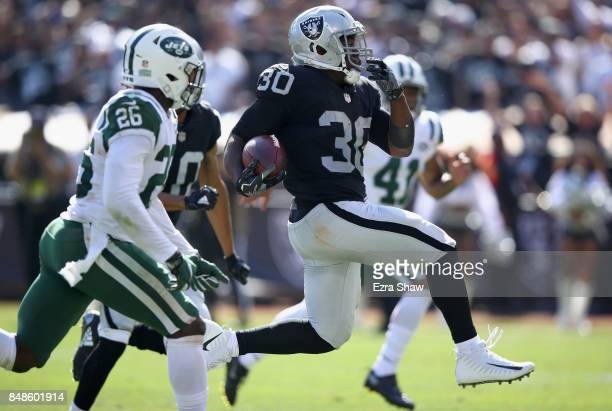 Jalen Richard of the Oakland Raiders breaks free on his way to scoring a touchdown against the New York Jets at OaklandAlameda County Coliseum on...