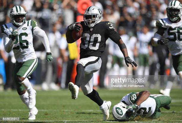 Jalen Richard of the Oakland Raiders scores on a 52 yard touchdown run against the New York Jets during the fourth quarter of their NFL football game...