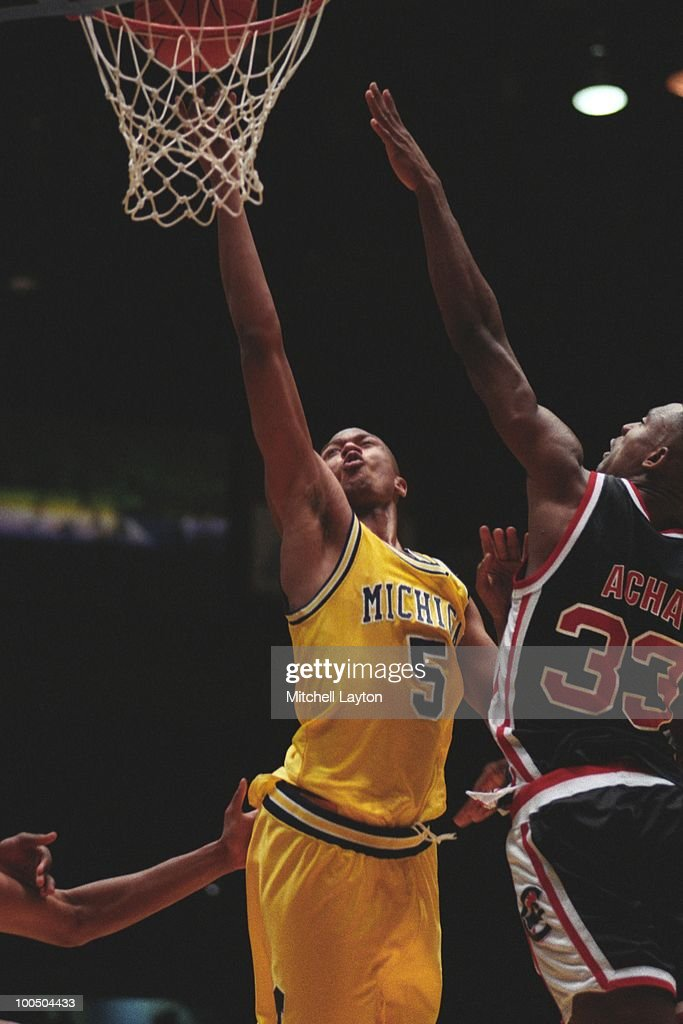 Jalen Rose #5 of the Michigan Wolverines drives to the basket against Coastal Carolina during a NCAA first round basketball game at the McKale Center on March 19, 1993 in Tuscon, Arizona..